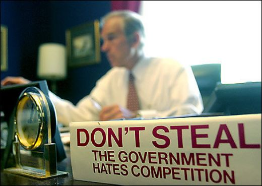 "A picture of Ron Paul with the ""Don't steal, the government hates competition"" sign."