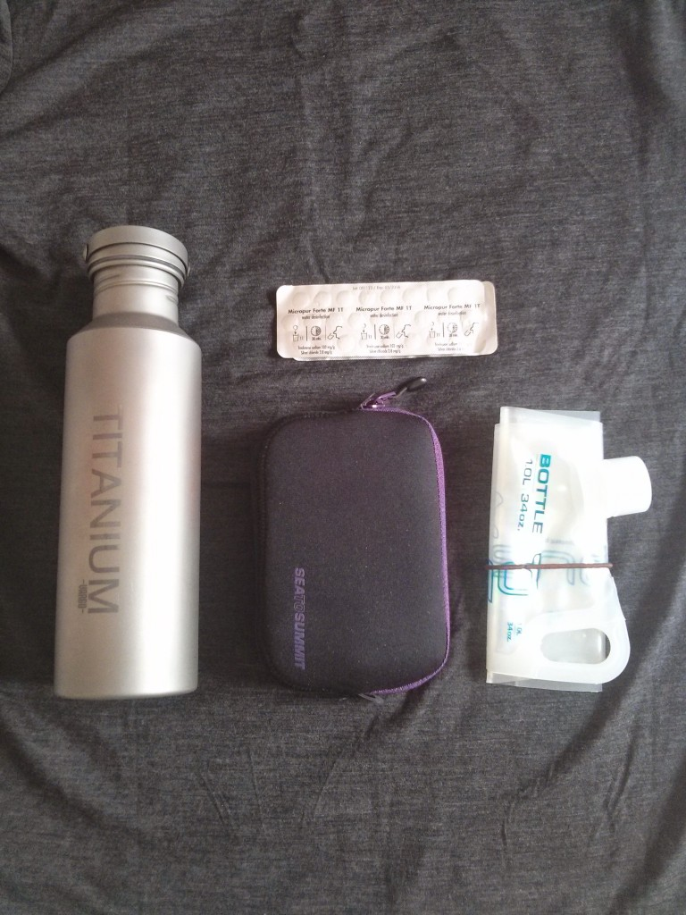 Clockwise: Vargo titanium water bottle, Katadyn Micropur Forte tablets, Platypus Plus 1L bottle, and Sea to Summit padded pouch (M)