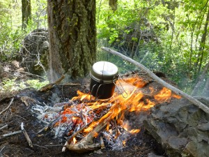 Survival rule of threes. A pot over a fire.